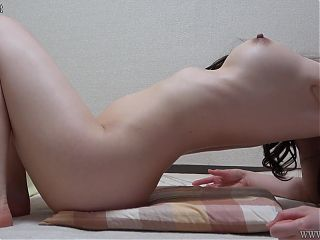 Glamorous Japanese Girl Naked and Kneads Her Tits